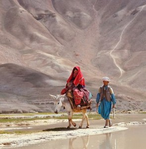 A couple, the woman on a donkey, travel along the road near Band-i-Amir in Afghanistan. ©Ric Ergenbright